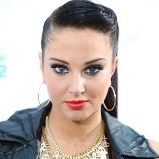 Tulisa Contostavlos has received an apology over a sex tape that appeared on the internet