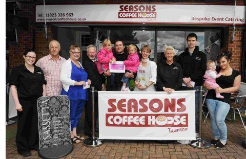 Winner Neil Jolly and his daughters Danielle and Alanna are pictured centre outside Seasons Coffee House