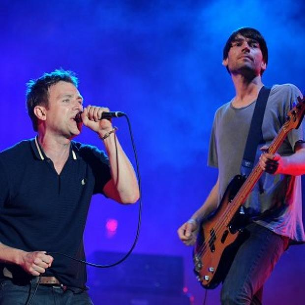 Damon Albarn and Alex James have reunited with the rest of Blur for their first concert in three years