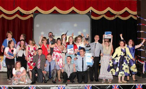 Foxes Academy leavers group celebrate their graduation on stage. PHOTO: Steve Guscott