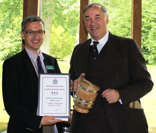 John Clegg of John Clegg & Co presents the Royal Forestry Society's Duke of Cornwall Award for Multipurpose Forestry to William Theed of Combe Sydenham Country Park.