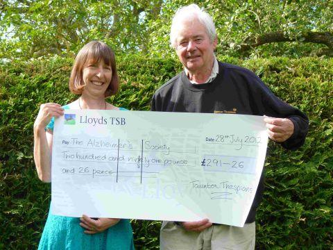 Jill Lock, support services manager of Alzheimer's Society, receives a cheque for £291.26 from Ron Roberts, vice chairman of Taunton Thespians