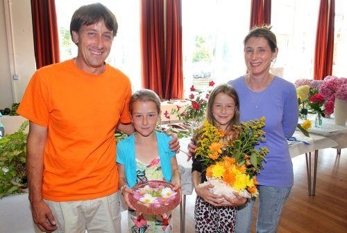 THE Towells family, from left, dad Darren, twins Elizabeth and Catherine with their exhibits and mum Sarah. PHOTO: Steve Guscott
