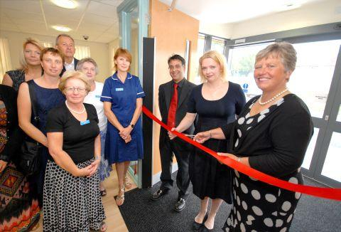 Jane Barrie OBE cuts the ribbon marking the official opening of the new Creech Medical Centre in the village of Creech St Michael, Near Taunton