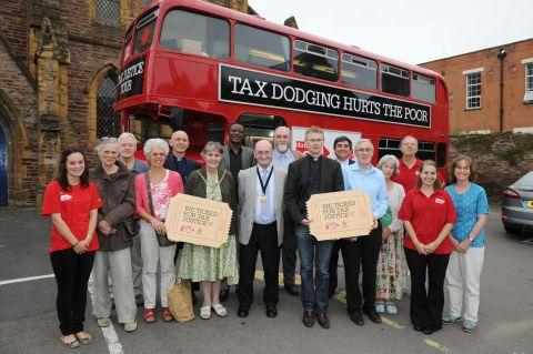 Pay your taxes, says bus full of preachers
