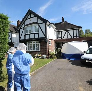 Forensic officers outside the home of the French shooting victim in Claygate, Surrey