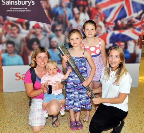 Racheal Hubbard with little Tilly, Libby, seven, Amy, ten, and Nikki of Sainsbury's