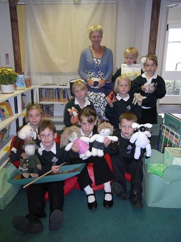 Headteacher Amanda Russell with some of the children and the story sack.