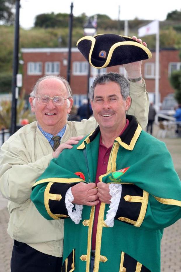 Alec Danby hands over the reigns of Watchet town crier to David Milton. PHOTO: Steve Guscott