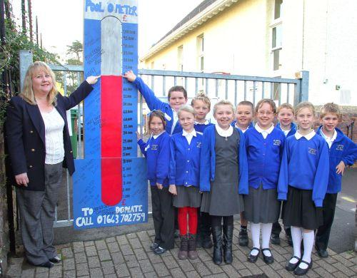 St Michael's PTA chair Tracey Sweetland with pupils. PHOTO: Steve Guscott