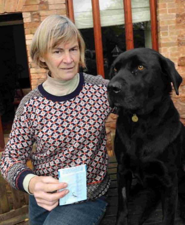 Owner Caroline Brown with black labrador Duke. PHOTO: Geoff Hall