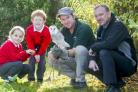 Chris Sperring MBE, a leading figure in Somerset  conservation, with Beau and pupils Katie Sanders and  Guy Schofield, and Simon Shirley from Western Power.