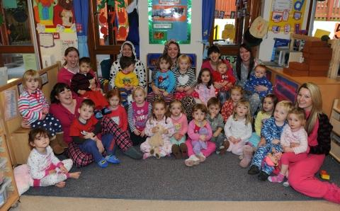 Staff and children at Brock House Day Nursery in Norton Fitzwarren.