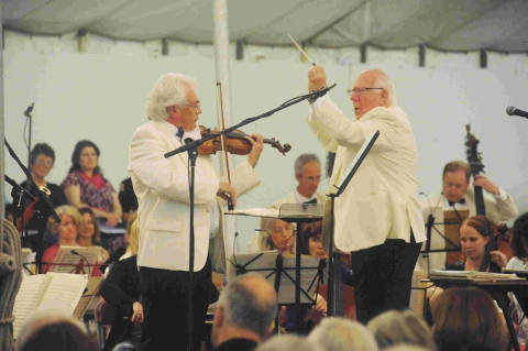 Conductor John Cole, right.