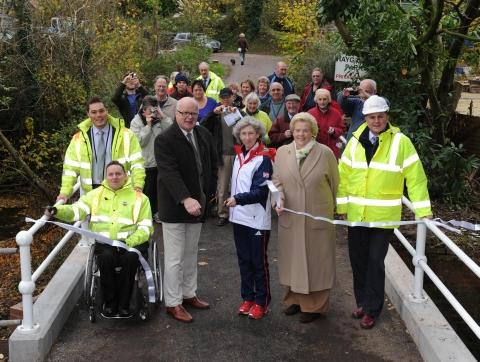 The opening of the new bridge in Mill Lane, Trull, by Deb Criddle with the help of county councillor Stephen Martin-Scott, parish council chair Jo Wooldridge and villagers.