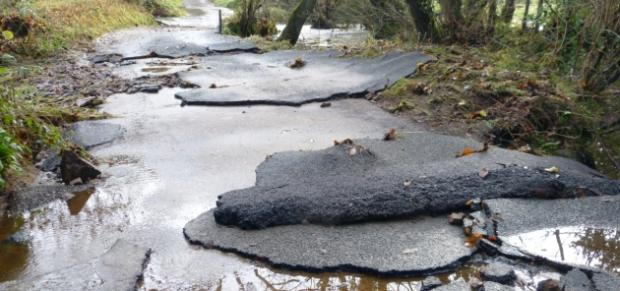 Shocking damage to road revealed as floods subside