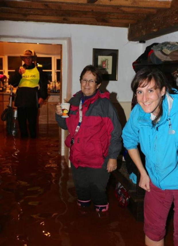 DOUG and Christine Human in their flooded home with their son's partner, Helen Mahoney. PHOTO: Gray Human