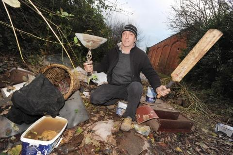 Steffan Jennings with some of the dumped rubbish.