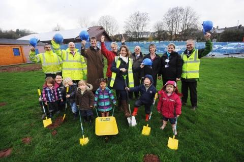 The turf cutting at the site of the new Lister House Surgery with Dr Sarah Burford performing the cut, helped by children from the Paddocks Nursery at Wiveliscombe Children's Centre.