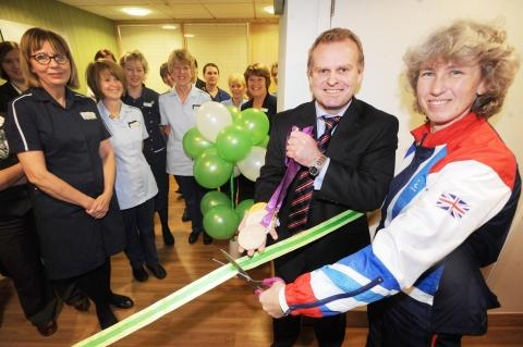 Deb Criddle opens the health-style suite with hospital director Paul Taylor.