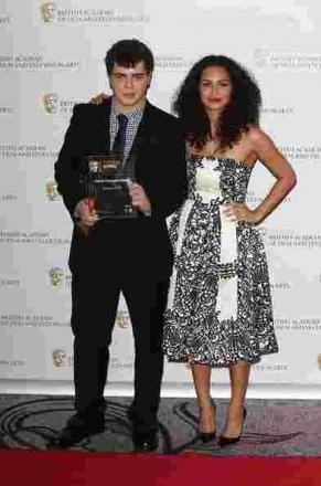Charlie Hutton-Pattemore receives his BAFTA award from Anna Shaffer.