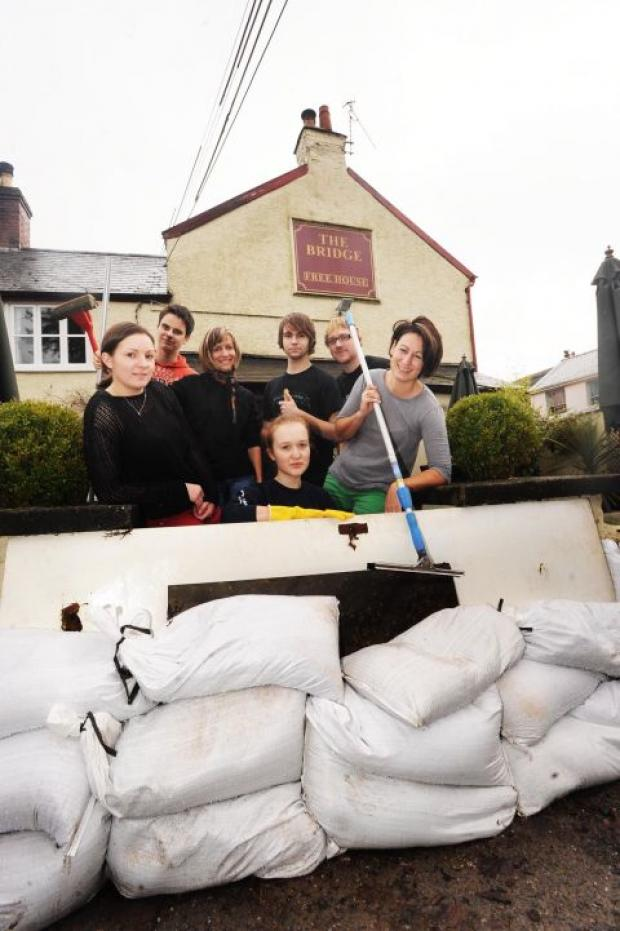 Owner Rachel McDonald (right) with staff from The Bridge Inn start the clean-up operation.
