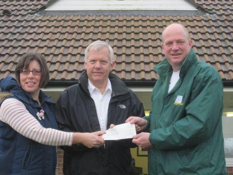 FOOTBALL club treasurer Hayley Perry and cricket chairman James Midgley receive the grant from county councillor David Fothergill.