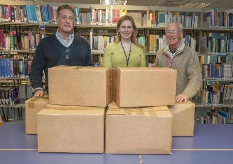Somerset County Gazette: Richard and Jonathon Meads accepting the latest donation of books from Jolanta Peters.