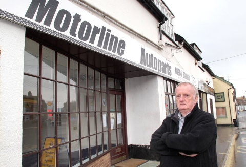 John Slade outside Motorline in Williton, which he has been forced to close due to ill health. PHOTO: Steve Guscott
