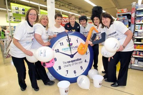 Minehead Co-operative staff Chris Mullally, Sue Hole, Maxine Floyd, Fiona Haigh, Robert Trice, Frances Agnew and Alison Cornish get into the swing of things. PHOTO: Steve Guscott
