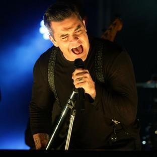 Robbie Williams is to be best man and wedding singer at his dad's nuptials