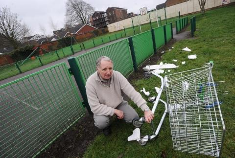 Cllr Dave Mitton with some unwanted rubbish tipped at Tonedale play area.