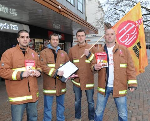 Firefighters collecting signatures in Taunton last month.