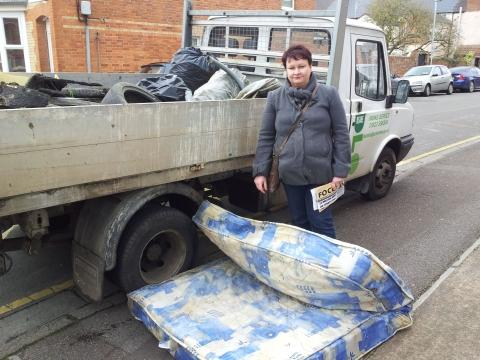 Justine Baker with the rubbish dumped outside the school.