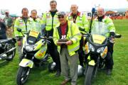 Yeovil Freewheeler volunteers present Mr Cecil Turner with a birthday cake.