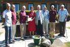 ROTARIANS present a cheque to senior hospital matron Norma Coombes.