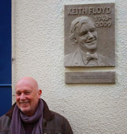 Sculptor John Alder next to the plaque of Keith Floyd, in Silver Street.
