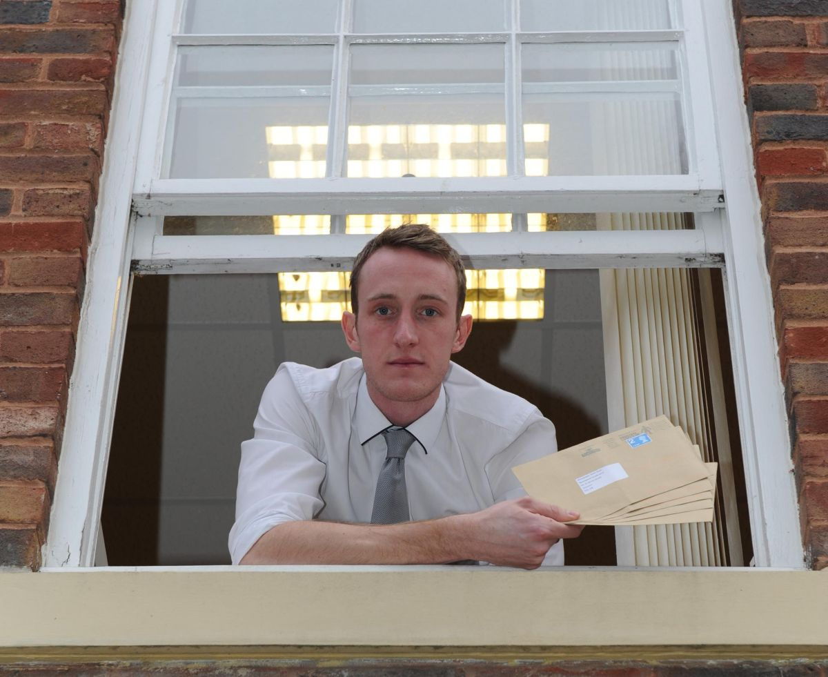 Reporter Dan Milligan tests out PG Wodehouse's letter posting technique. PHOTO: Geoff Hall.