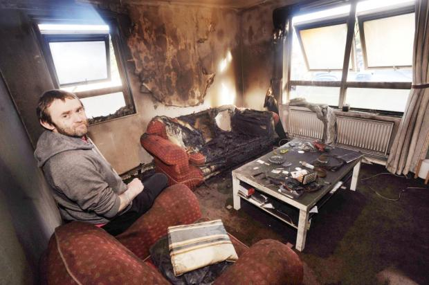 Somerset County Gazette: Tyrone Meigh - told he can live in the flat even though it has been badly damaged by smoke.