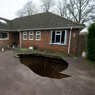 Somerset County Gazette: The home of Phil and Liz Conran, High Wycombe, after a 30ft-deep sinkhole opened up in the driveway and swallowed their car