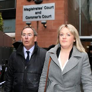 Somerset County Gazette: Fred Talbot leaves Manchester Magistrates Court with an unidentified woman, where the TV weatherman is charged with nine counts of indecent assault and a sexual assault.