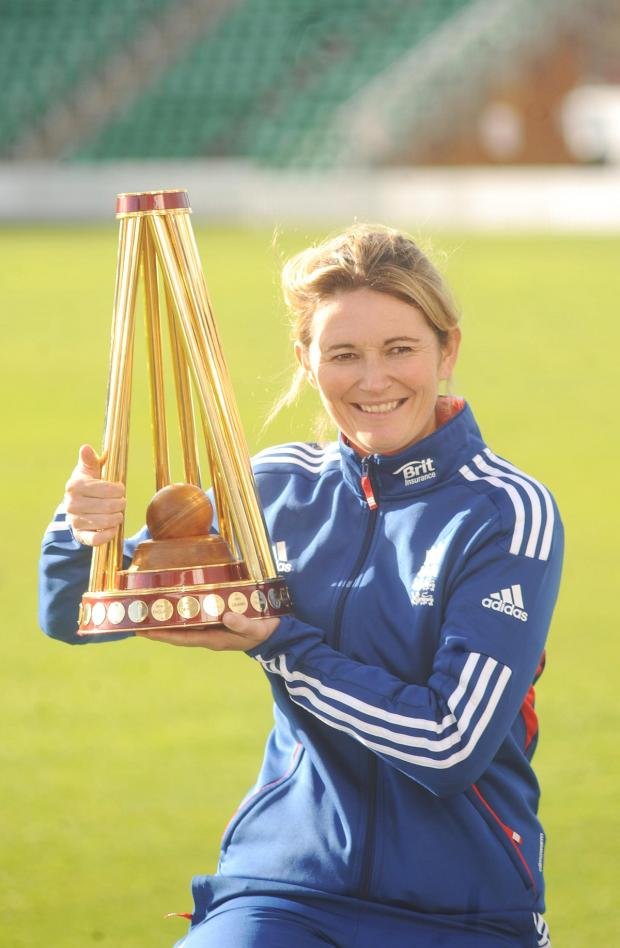 Somerset County Gazette: England Women's captain Charlotte Edwards holds the Ashes trophy during her visit to the County Gr