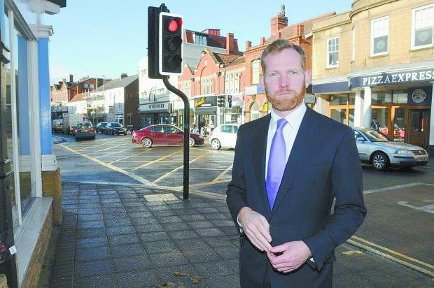 Somerset County Gazette: Jeremy Browne MP wants the traffic lights on Bridge Street re-phased to stop the build-up of cars in the town centre.