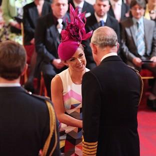 Singer Katherine Jenkins is made an OBE by the Prince of Wales during an investiture ceremony at Buckingham Palace