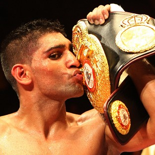 Champion Amir Khan said he would not allow his son or daughter to become a boxer