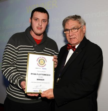 RYAN Flottemesch receives his award from Nigel Handbury, president of the Rotary Club of Taunton.