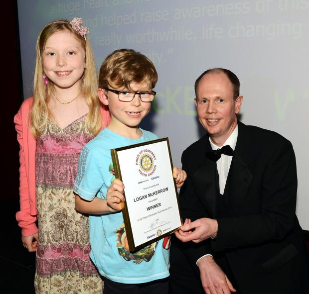 Logan and his sister collect the award from Alex Cameron, editor of the Somerset County Gazette series