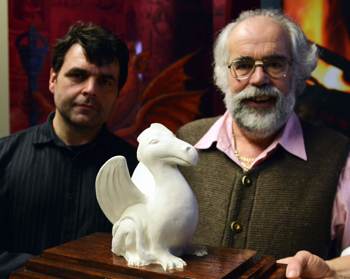 PROJECT spokesman Mike Marshall, right, with artist Tim Hobbis, who will be making the dragons, with a small model that the full-size versions will be based on.