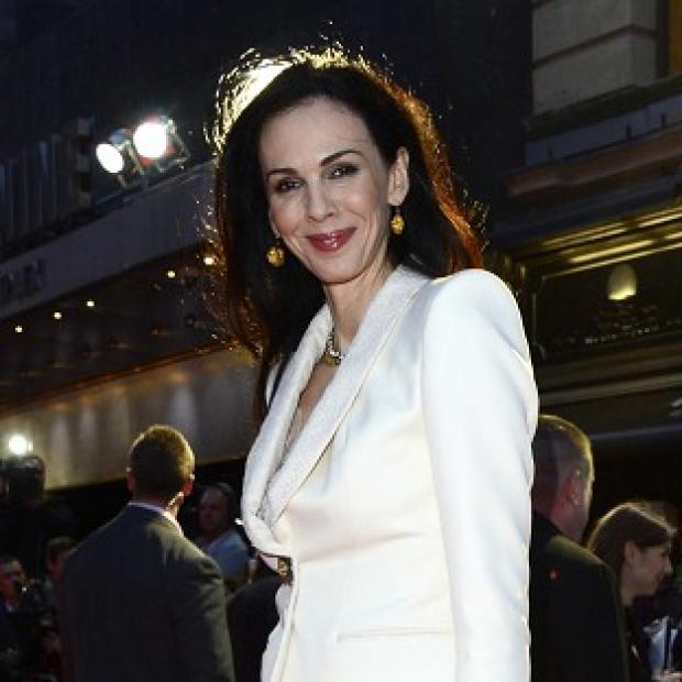Somerset County Gazette: Friends and family gave readings at the private funeral for L'Wren Scott