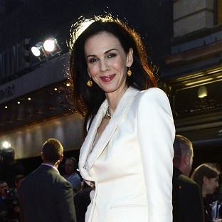 Friends and family gave readings at the private funeral for L'Wren Scott